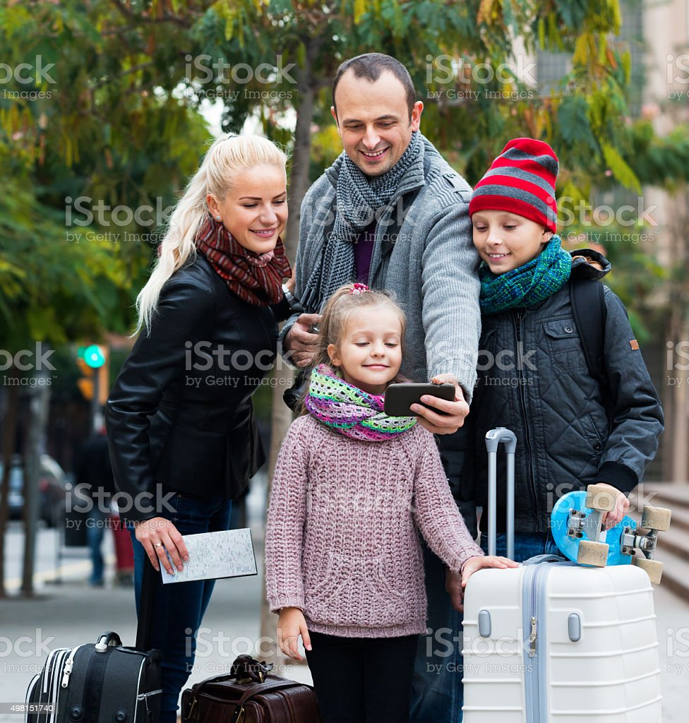 Parents with kids taking selfie stock photo