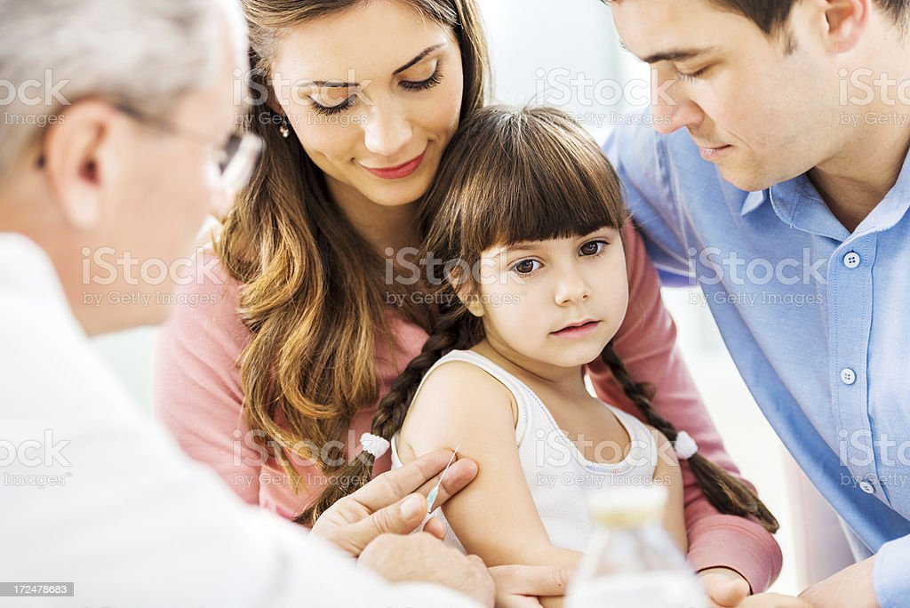 Parents with their cute daughter on her vaccination. royalty-free stock photo