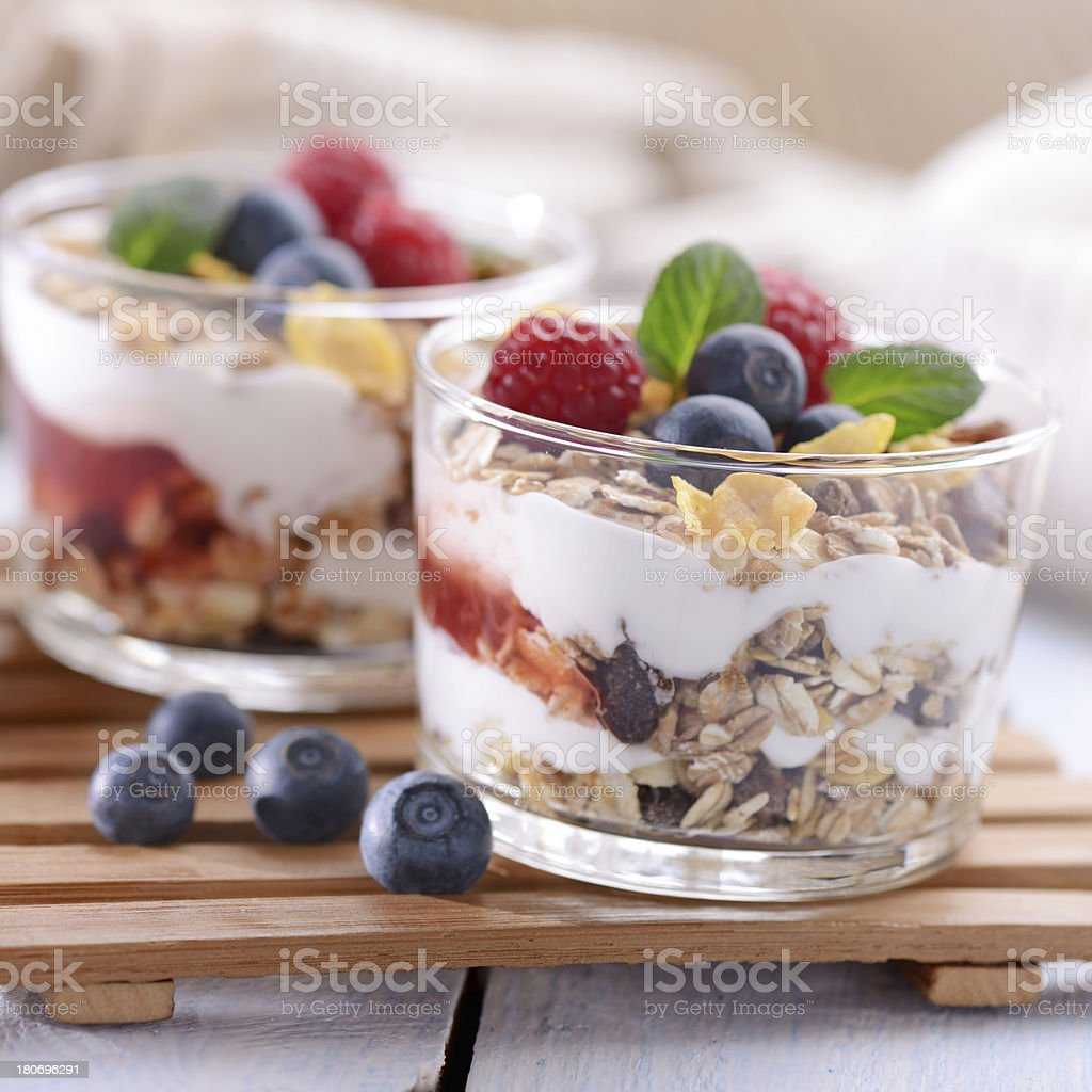 Parfait with yogurt, strawberry sauce, granola and fresh fruits stock photo