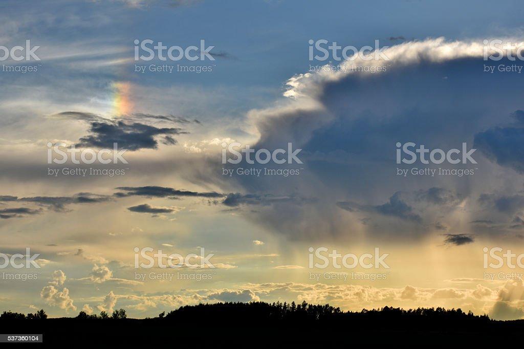 Parhelion phenomenon (sundog) next to a thundercloud stock photo