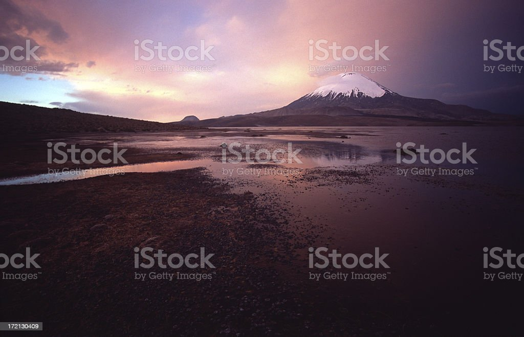 Parinacota volcano, mirrored in lake, at sunset stock photo