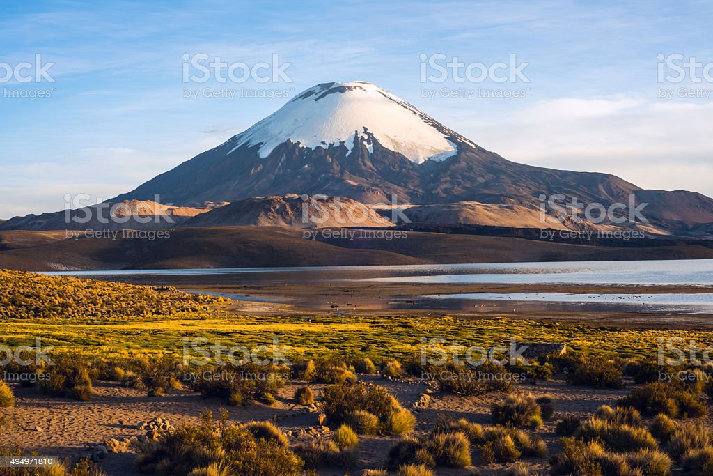 Parinacota Volcano reflected in the Lake Chungara, Chile stock photo