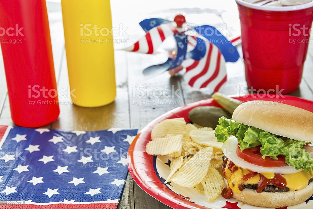 Pariotic-themed BBQ with chips and cheeseburger stock photo