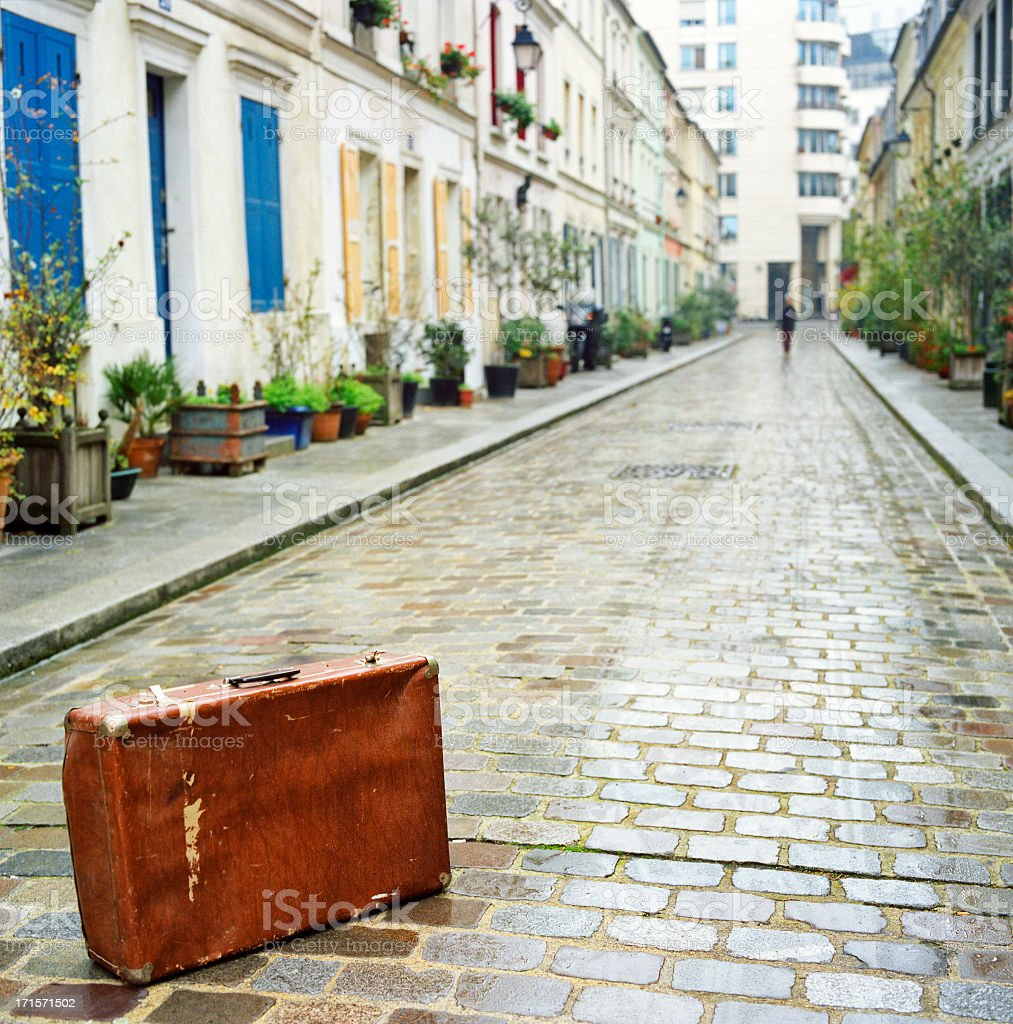 Paris, a suitcase is abandoned in the street stock photo