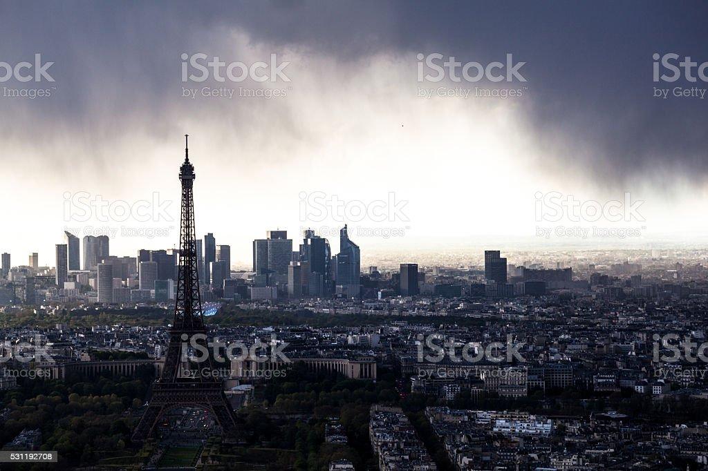 Paris and Eiffel Tower  silhouette skyline dark stormy spring evening stock photo