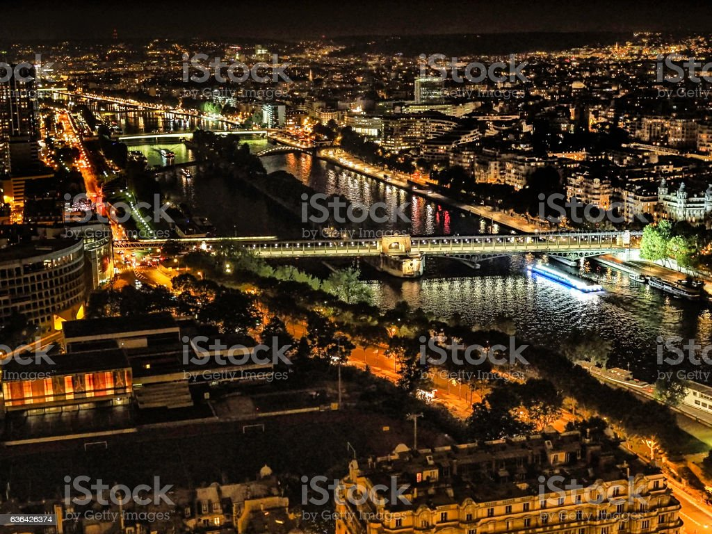 Paris and the Seine River at night stock photo