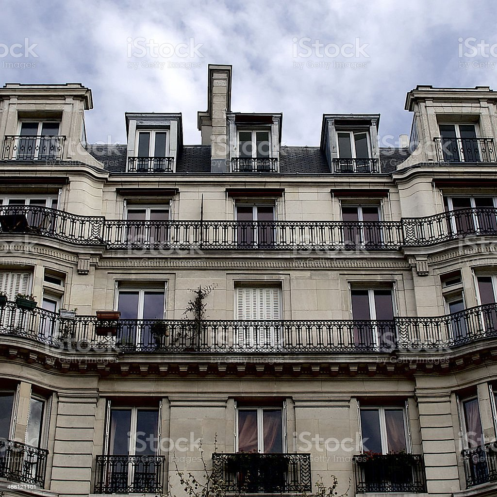Paris apartment building facade, chimneys, rooftop and balconies, French architecture royalty-free stock photo