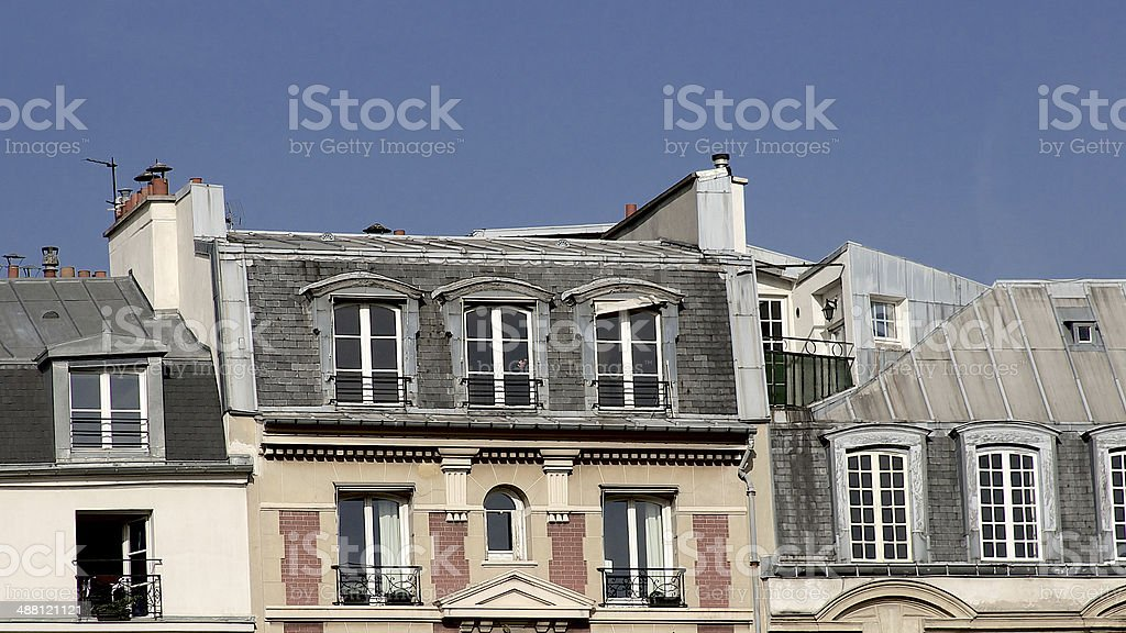 Paris apartment building facade, chimneys, rooftop, French architecture royalty-free stock photo
