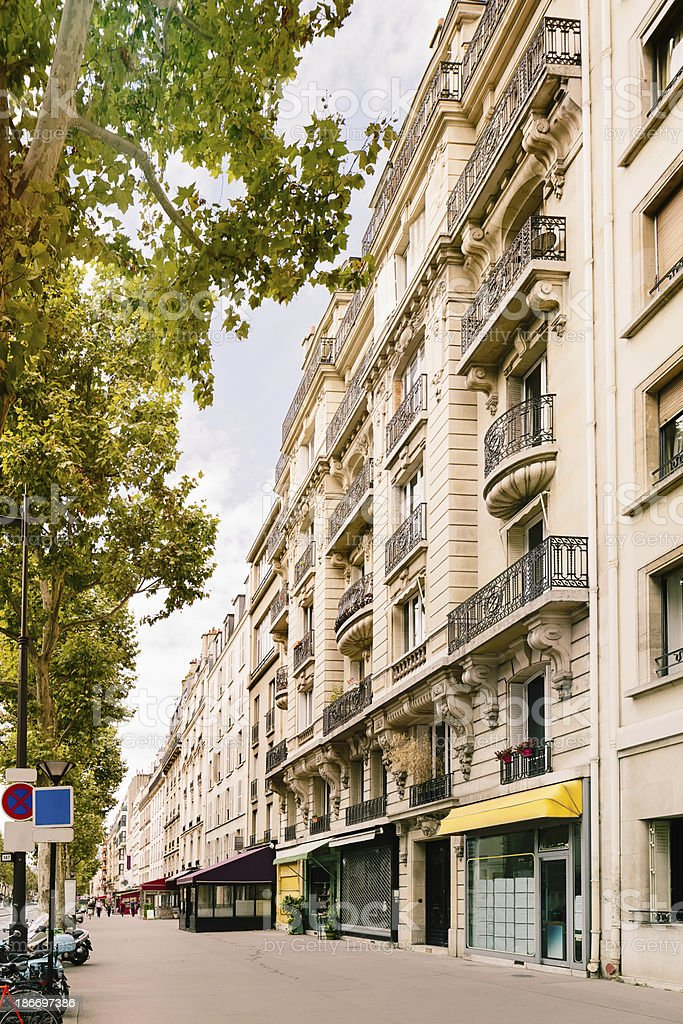 Paris boulevard with stores and apartments royalty-free stock photo