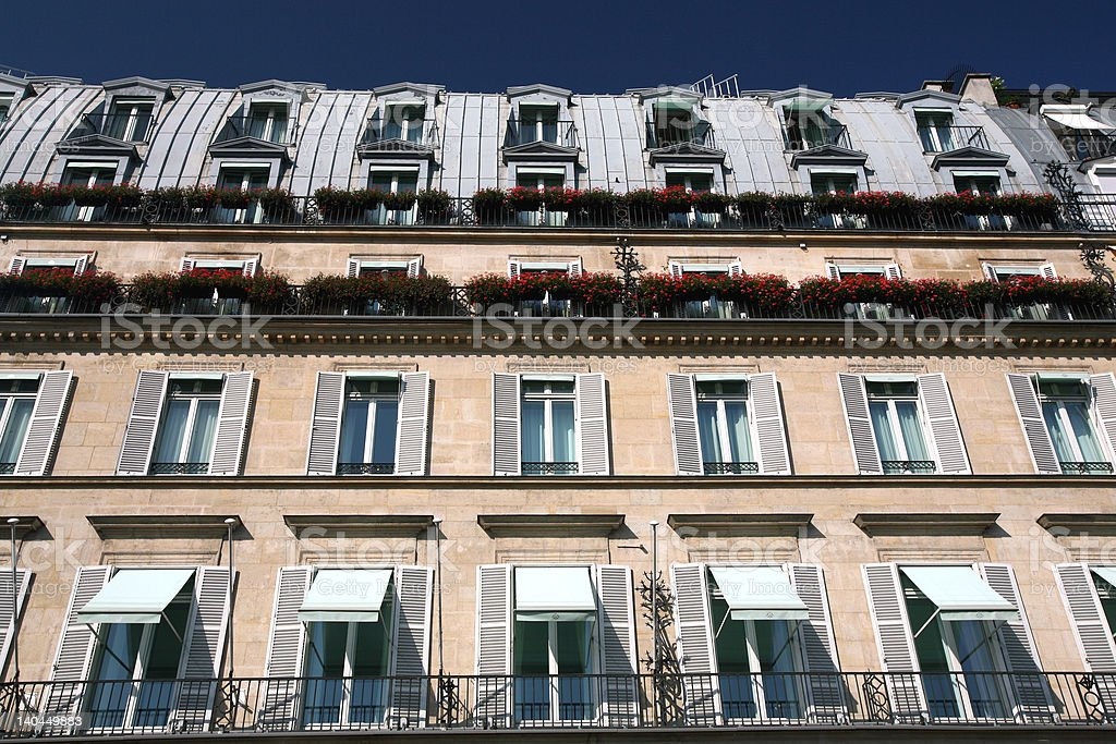 paris building facade balconies,shutters,plants royalty-free stock photo