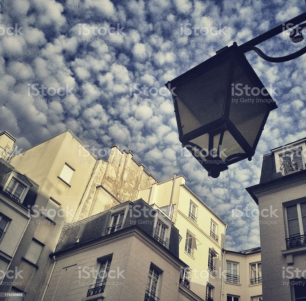 Paris Building with cloudy sky and Street Lamp royalty-free stock photo