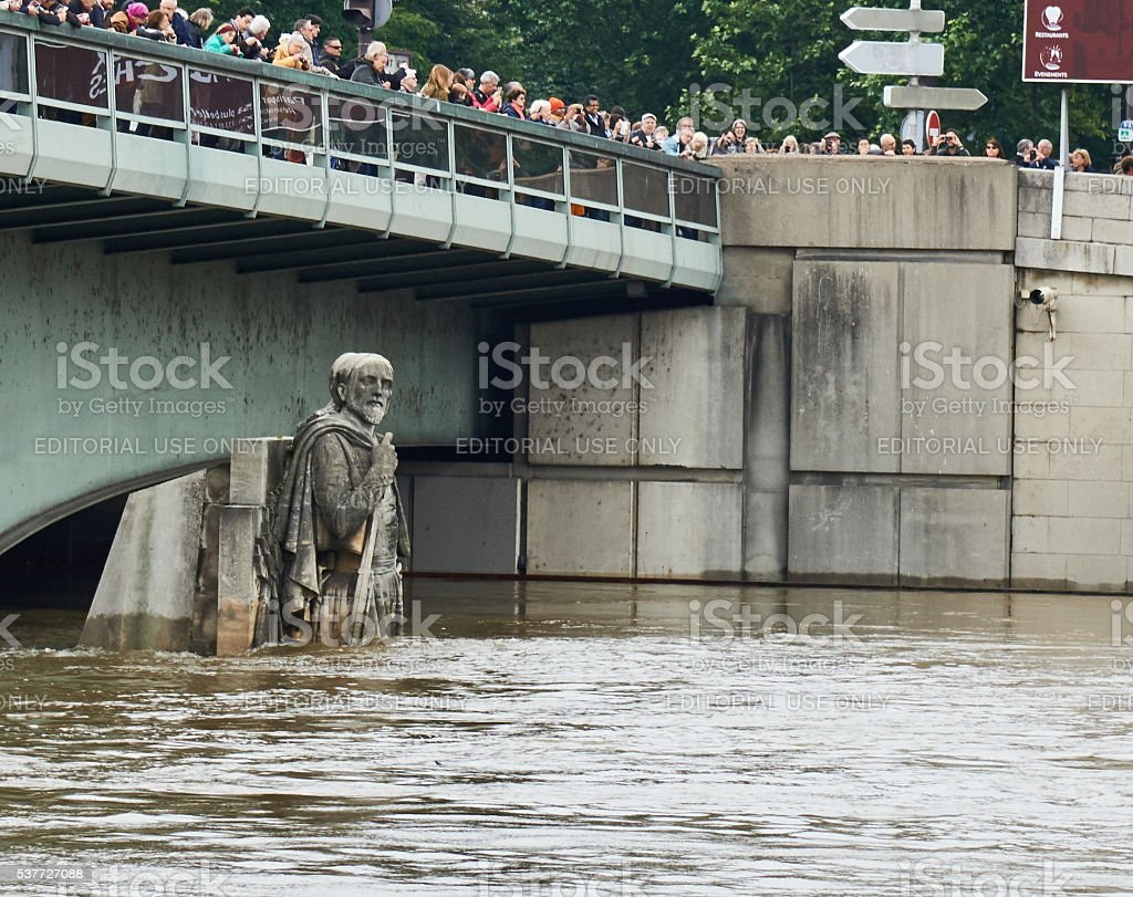 Paris floods and The Zouave statue Paris, France royalty-free stock photo