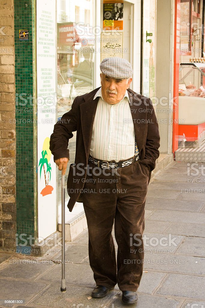 Paris, France: Senior Man with Cane and Traditional Hat stock photo