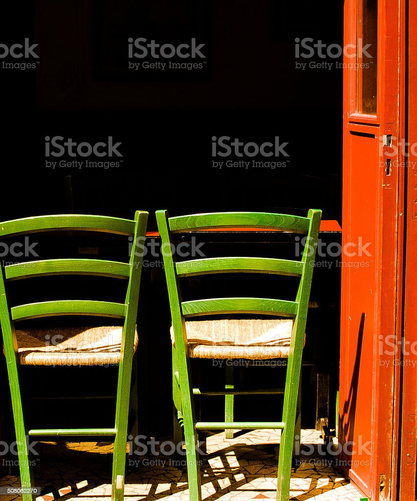 Paris, France: Vibrant Green Chairs and Red Door in Montmartre stock photo
