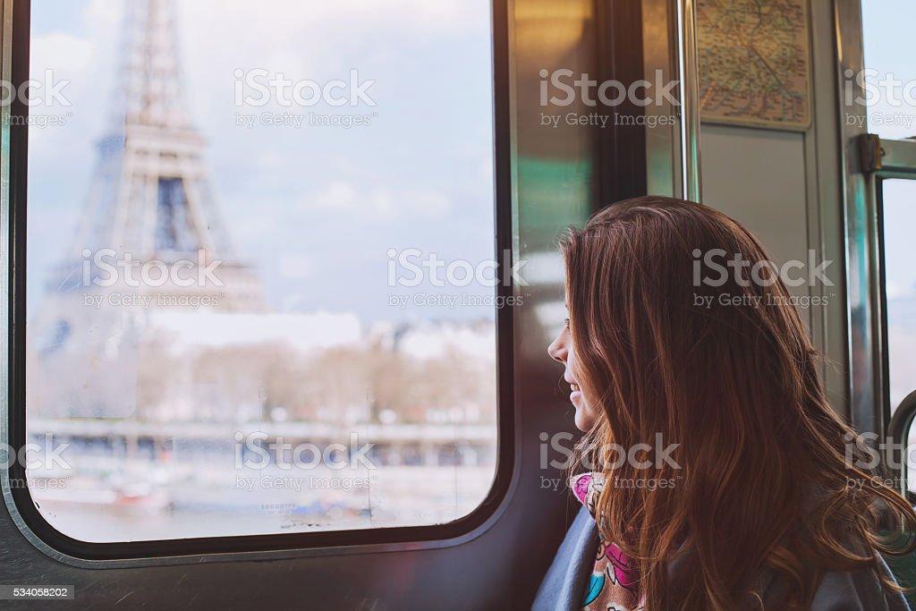 Paris, girl looking to Eiffel tower from metro train window stock photo
