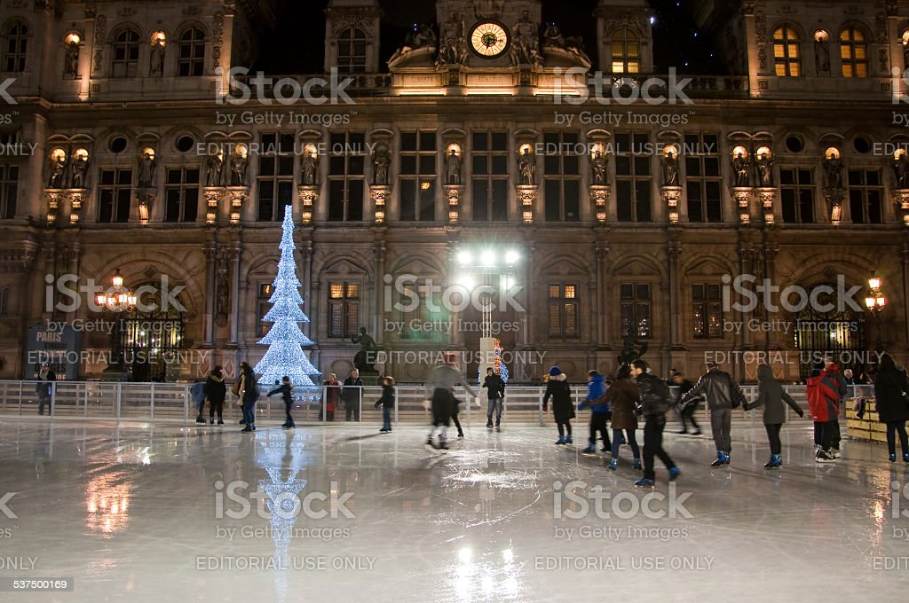Paris ice skating rink and Hotel de ville at night. stock photo