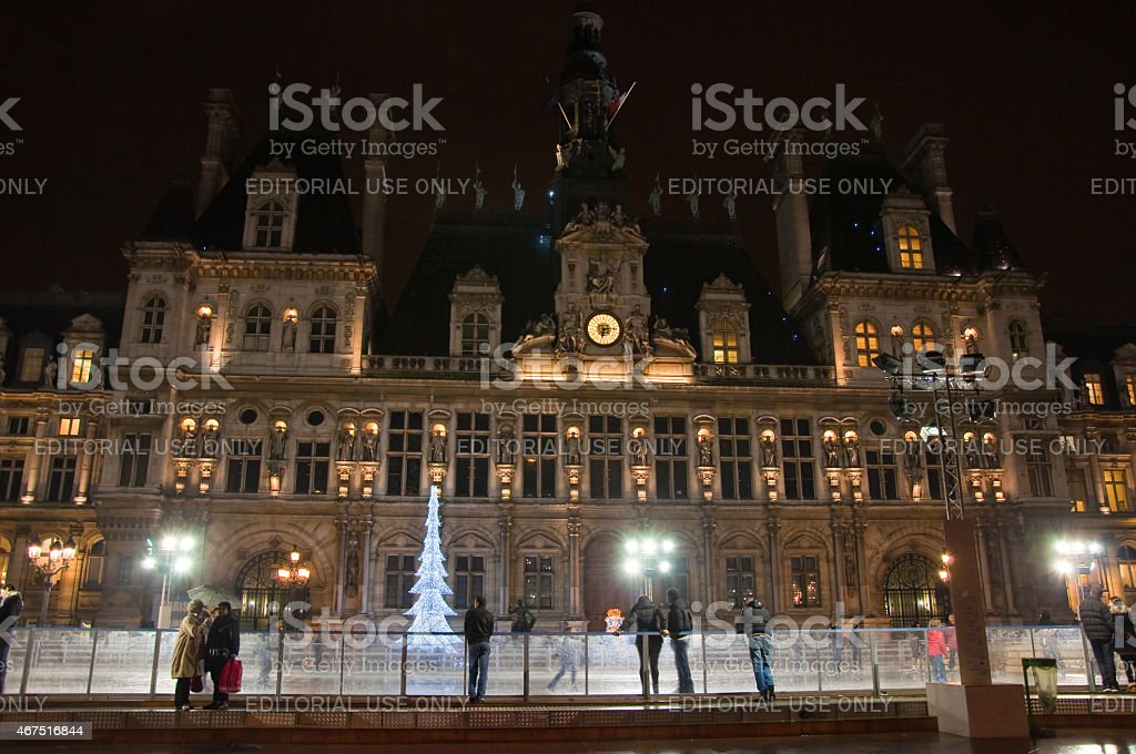 Paris ice skating rink and illuminated Hotel de ville. stock photo