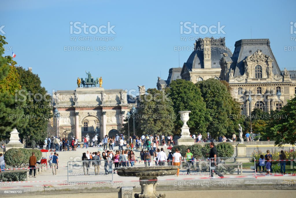 Paris -  Local and Tourist walking in famous Tuileries garden. stock photo
