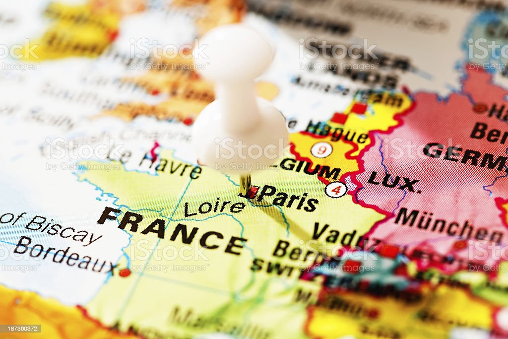 Paris marked by white pushpin on map of Europe royalty-free stock photo