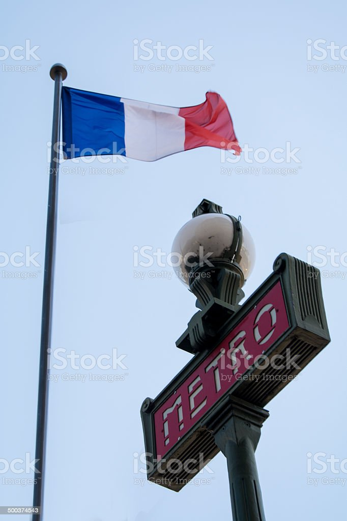 Paris Metro Sign And Flag Of France stock photo