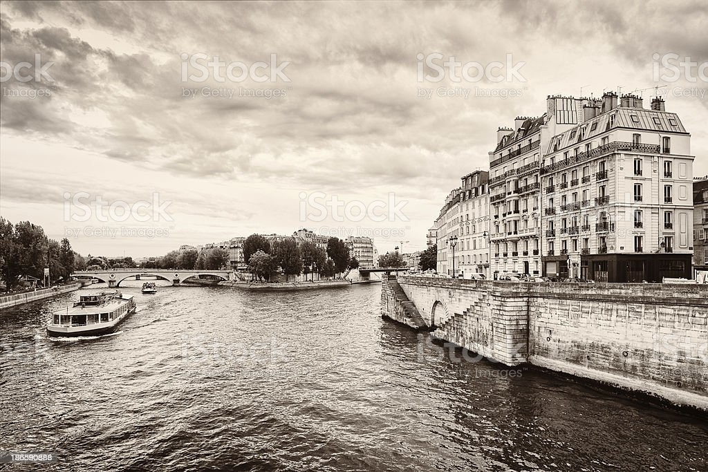 Paris Seine River with boat and Ile-Saint-Louis royalty-free stock photo