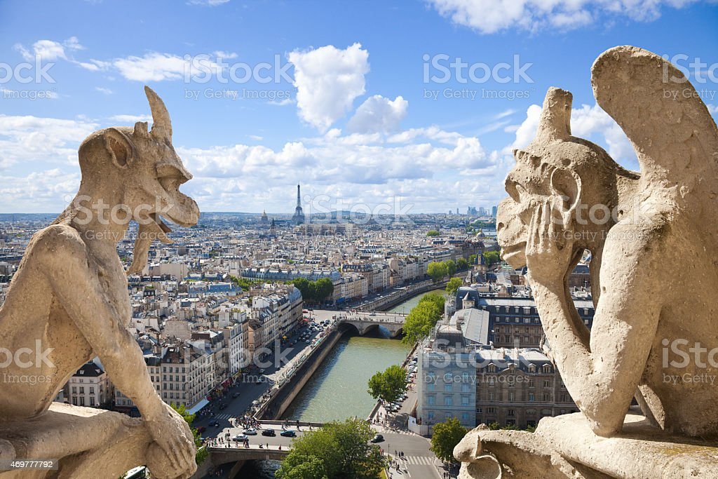 Paris skyline framed by two gargoyles of Notre Dame stock photo