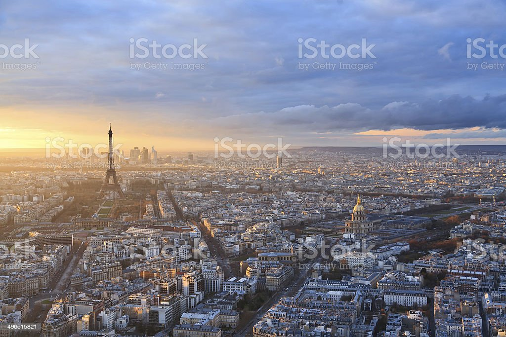 Paris skyline under a dramatic sky at sunset stock photo