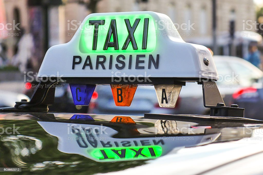 Paris taxi detail and Arc de Triomphe in the background stock photo