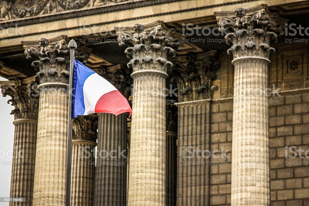 Paris - the French flag waving in the wind stock photo
