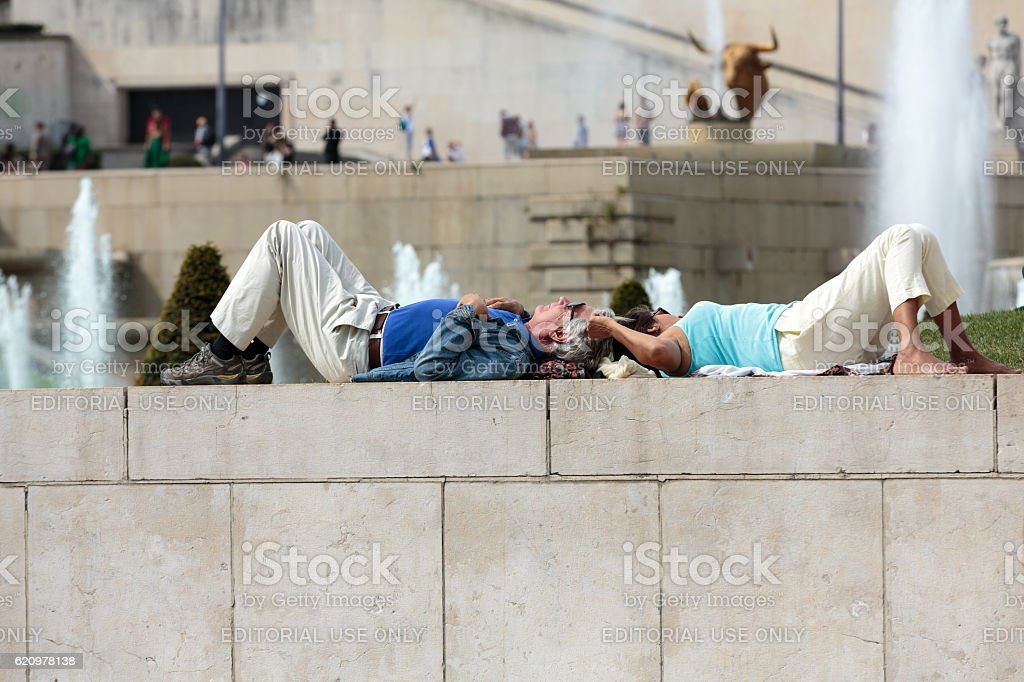 Paris -Two tourists rest at Fountains Tracadero. stock photo