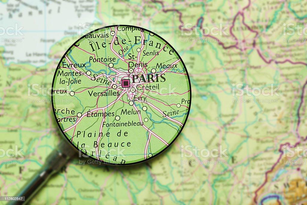 Paris under loupe stock photo