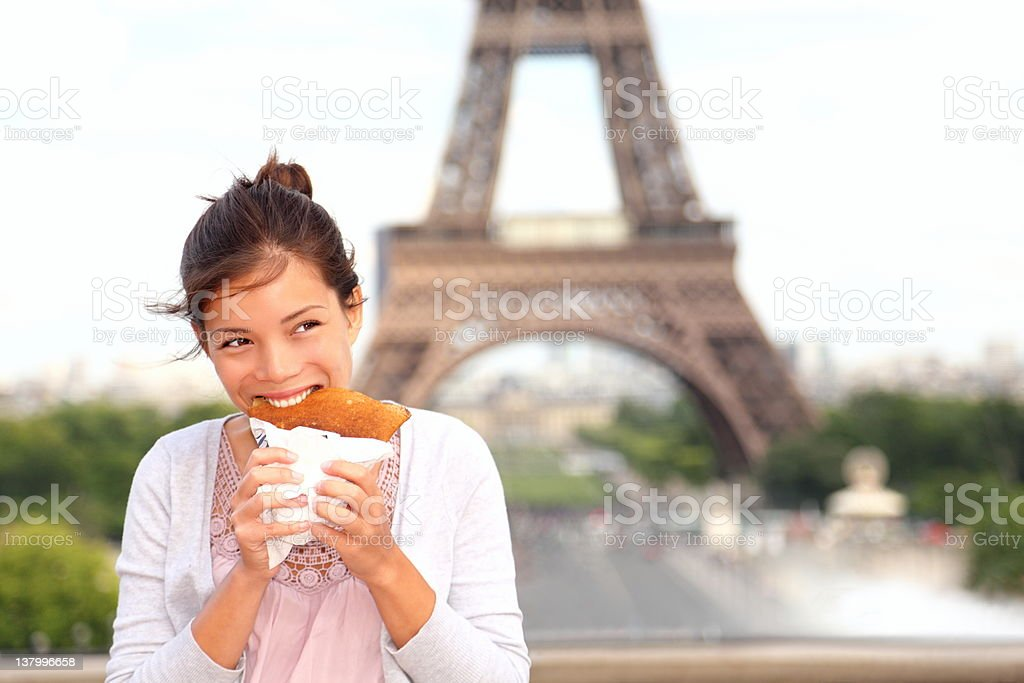 Paris woman by Eiffel Tower royalty-free stock photo