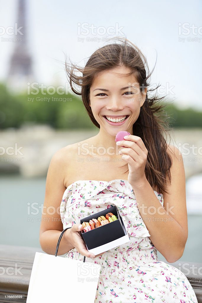 Paris woman eating macaron royalty-free stock photo