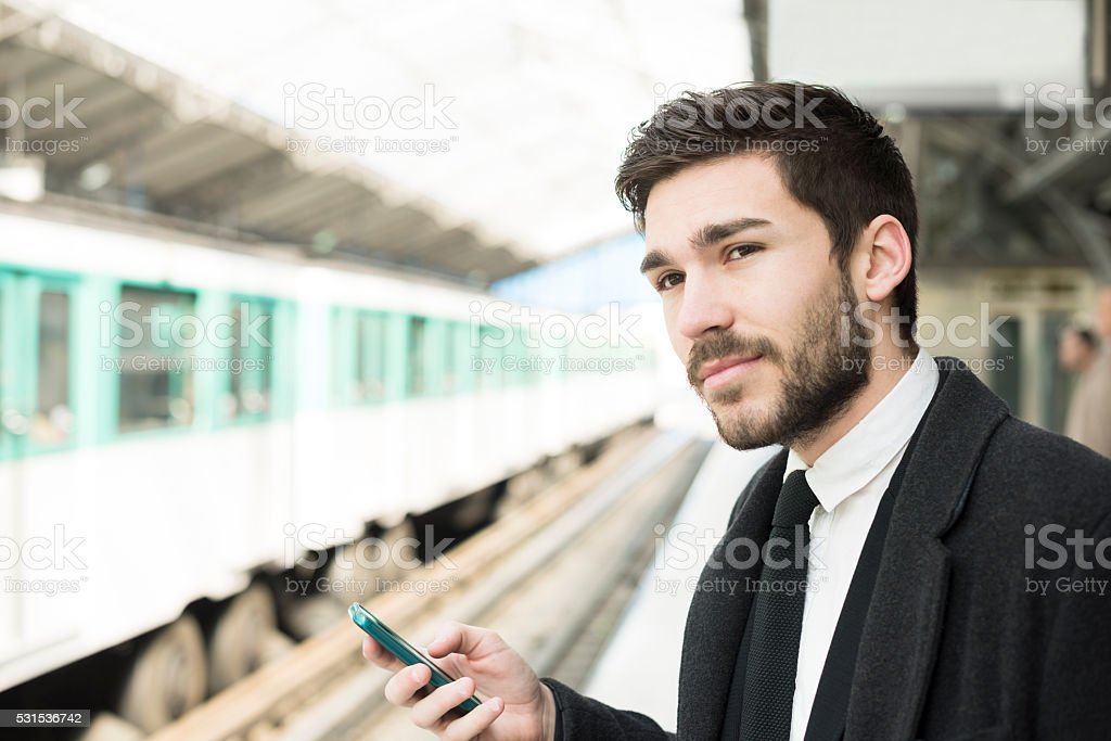Parisian commuter using metro transport smartphone app in Paris stock photo