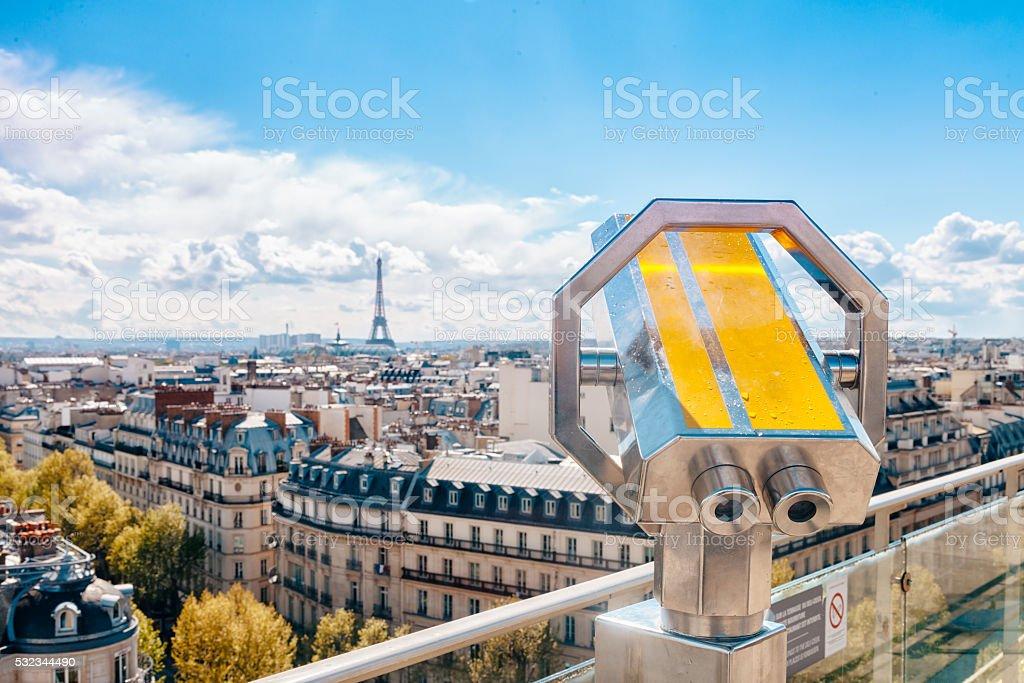 Parisian sightseeing telescope against city view stock photo