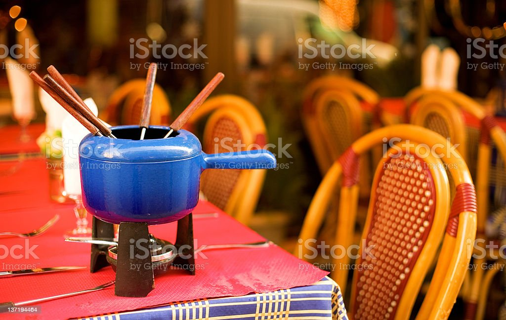 Parisian street cafe with earthenware pot for fondue stock photo