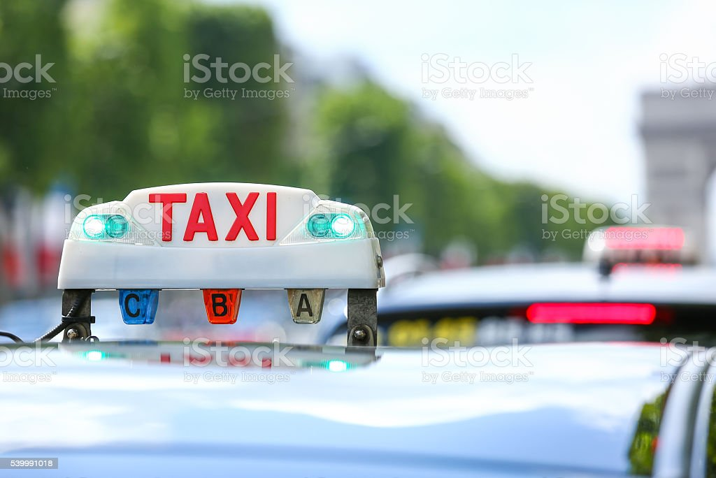 Parisian taxi in the city stock photo