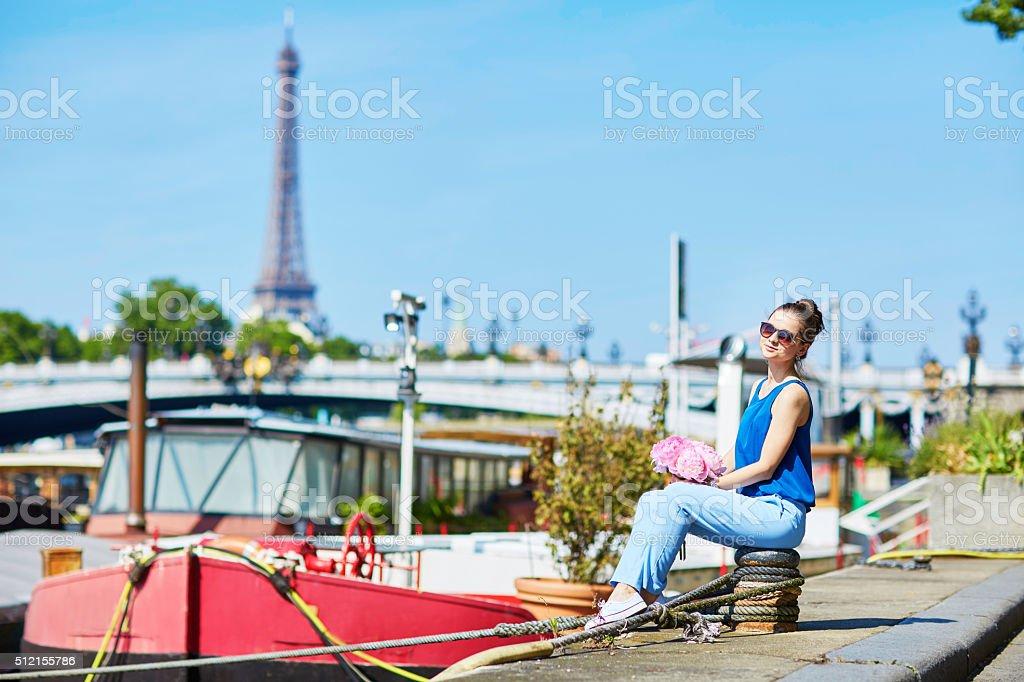 Parisian woman on the Alexandre III bridge in Paris stock photo