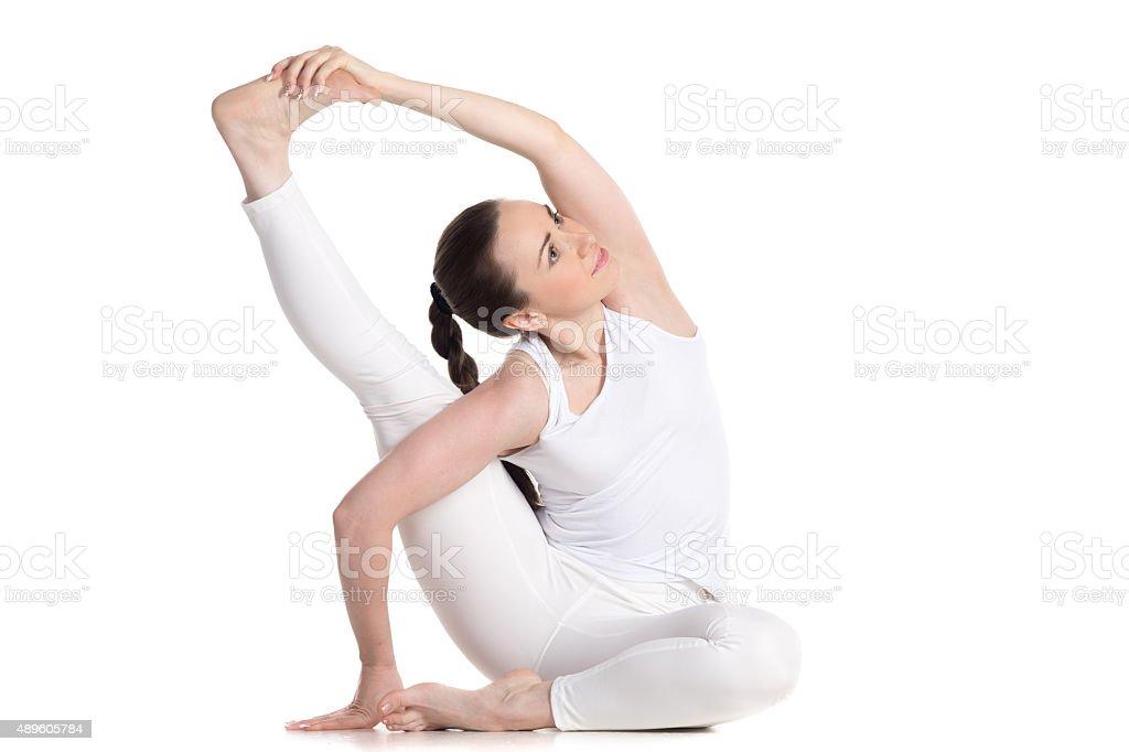 Parivritta Krounchasana yoga Pose stock photo