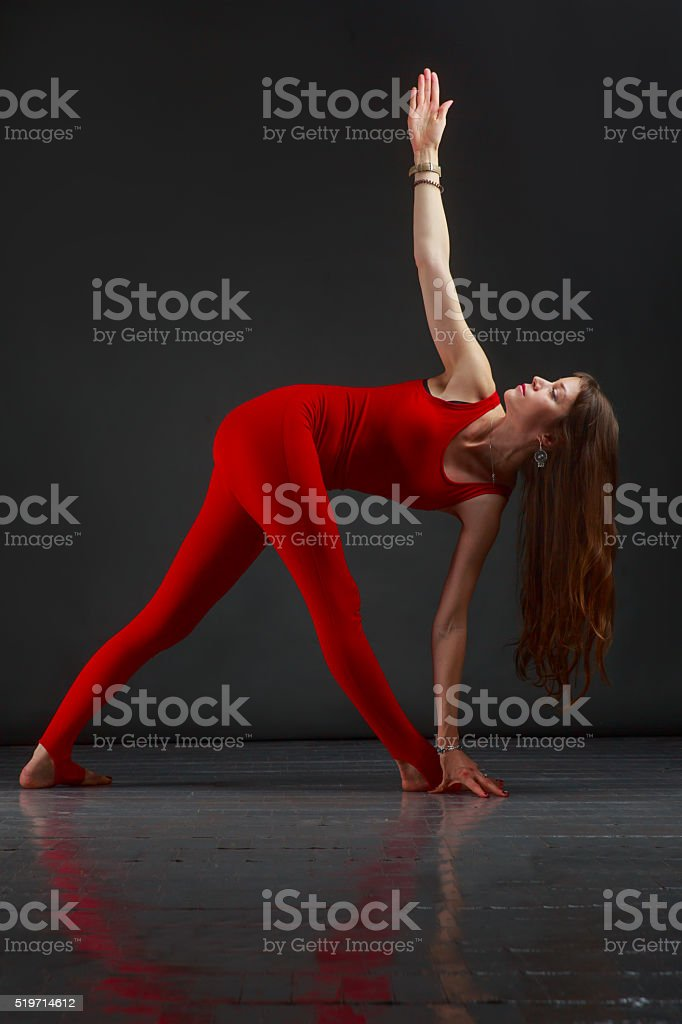 parivritta trikonasana yoga stock photo