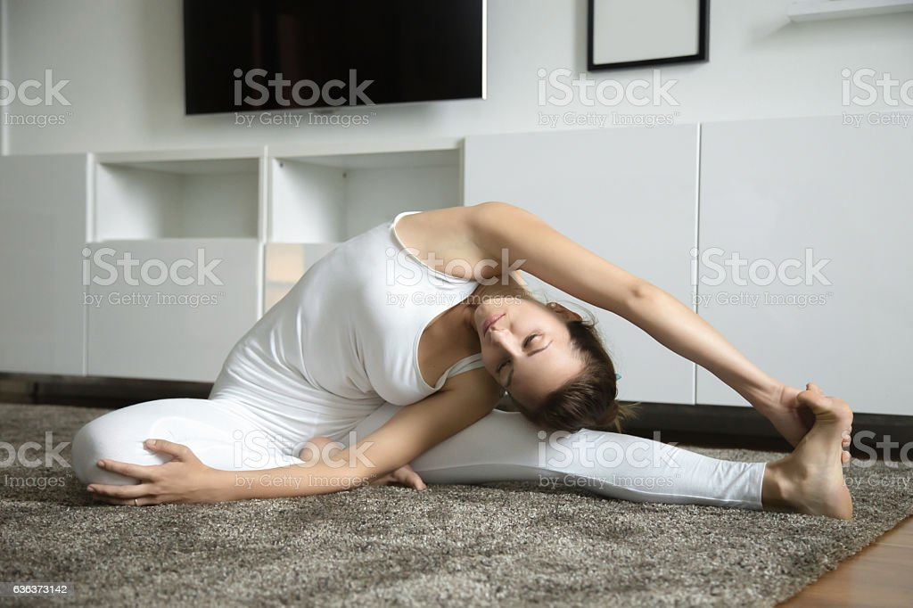 Parivrtta Janu Sirsasana stock photo