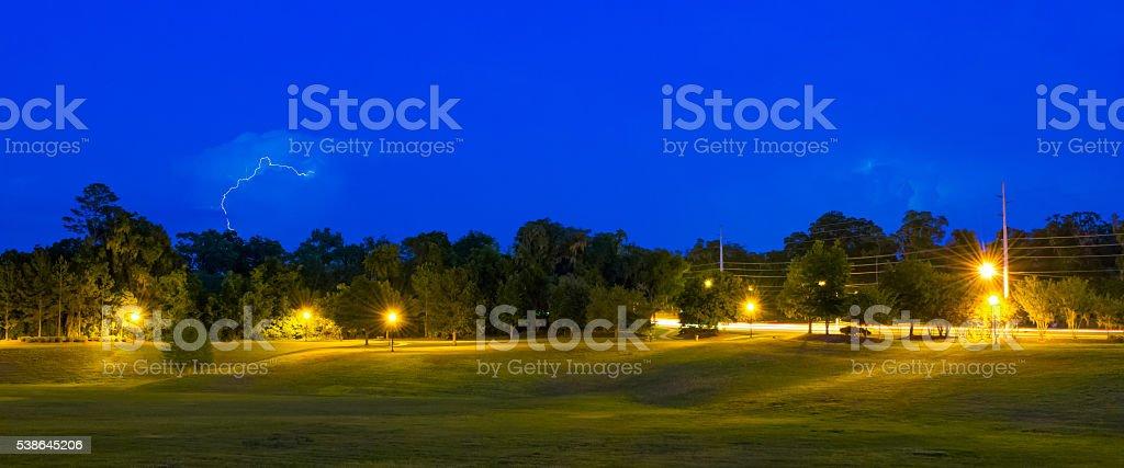 Park and Lightning at Dusk stock photo