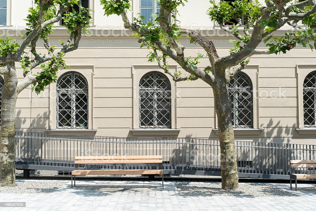 Park Bench at Elias Holl Square in Augsburg stock photo