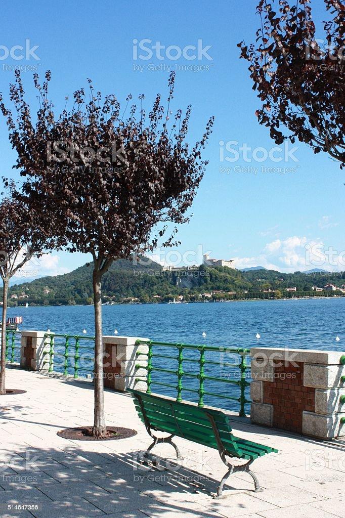 Park Bench by Lake Maggiore Arona view to Angera, Italy stock photo