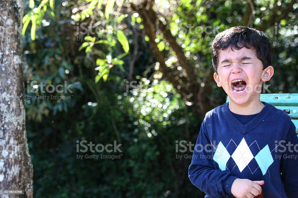 Park crying boy stock photo
