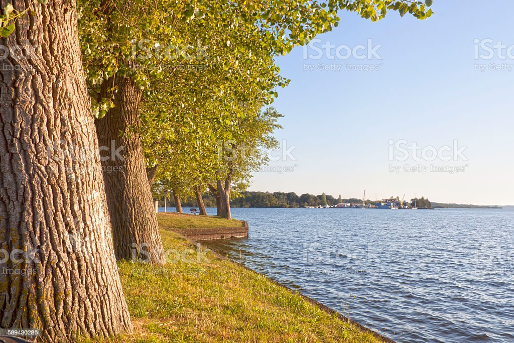 park in front of a fishing platform in a lake stock photo