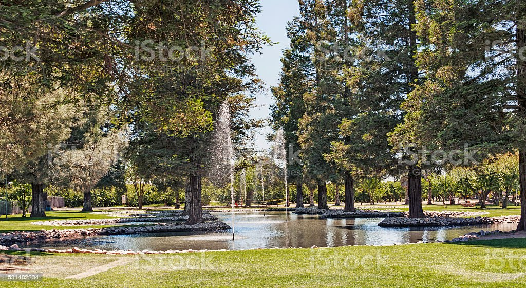 Park in Modesto California with Picnic area and Water Spray stock photo