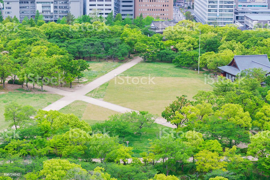 Park in Osaka city in Japan, view from castle. stock photo