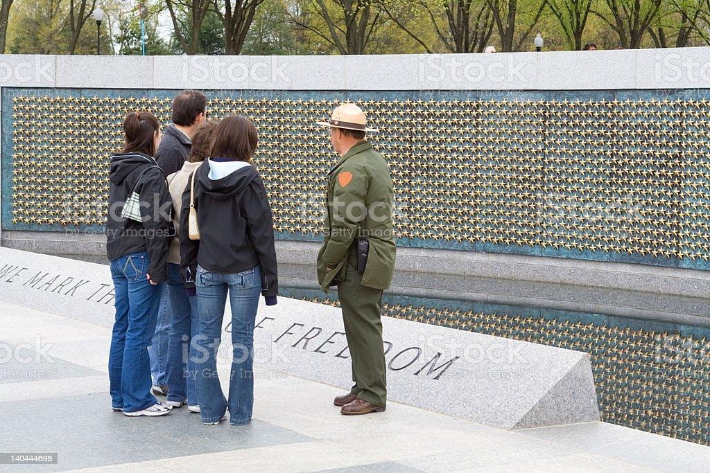 U.S. Park Ranger Explaining World War II Memorial To Tourists stock photo