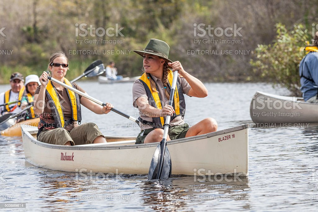Park Ranger Guides Tourists Down the Turner River stock photo